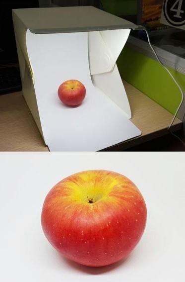 Mini Fotobox mit einem beleuchteten Apfel
